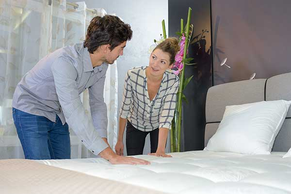 "Couple choosing mattress. The ""O"" Mattress best memory mattress in Canada"