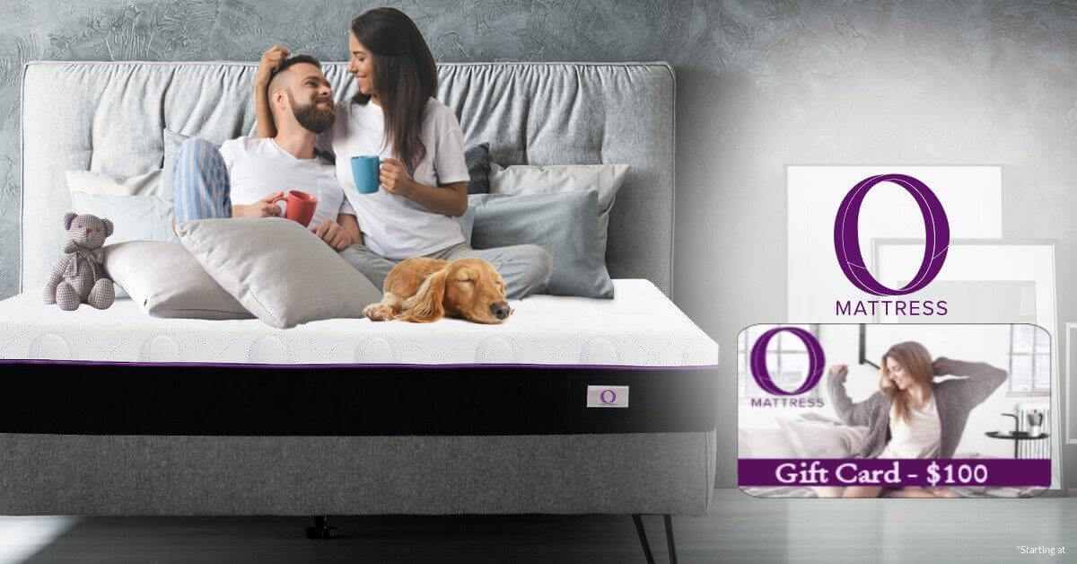 Omni Mattress Banner, Couple with mugs in a bed - Plus $100 gift card
