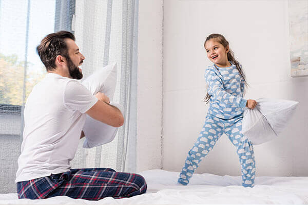 Father & Daughter Playing with pillows